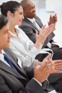 Business people are smiling and clapping