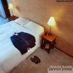 travel 1-3 clothes on hotel bed